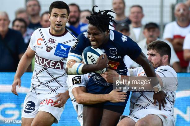 Agen's Nicolas Metge runs with the ball during the French Top 14 rugby union match between SU Agen and Union Bordeaux Begles on September 15 2018 at...