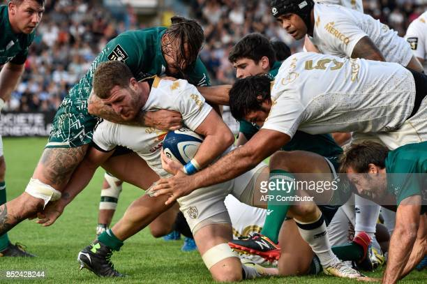 Agen's player Antoine Erbani runs with the ball during the French Top 14 rugby union match between SU Agen and Pau on September 23 2017 at the...
