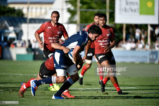 Agen's player Vincent Farre runs with the ball during the French Top 14 rugby union match between SU Agen and Toulon on August 24 2019 at the...