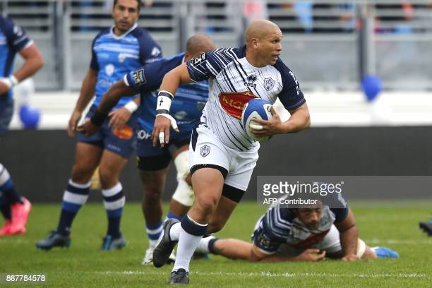 Agen's South African scrumhalf Enrico Januarie runs with the ball during the French Top 14 rugby union match between Castres and Agen at the Pierre...