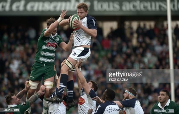 Agen's Tom Murday grabs the ball in a line out during the French Top 14 rugby union match between Pau and Agen at the Hameau stadium on April 14 in...
