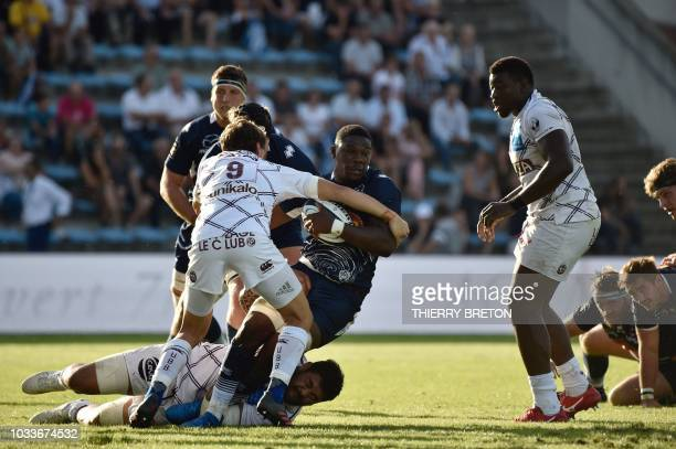 Agen's Yoan Tanga runs with the ball during the French Top 14 rugby union match between SU Agen and Union Bordeaux Begles on September 15 2018 at the...
