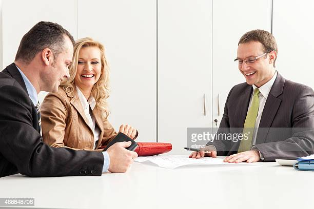 Agent Advises Happy Couple Over Blueprint