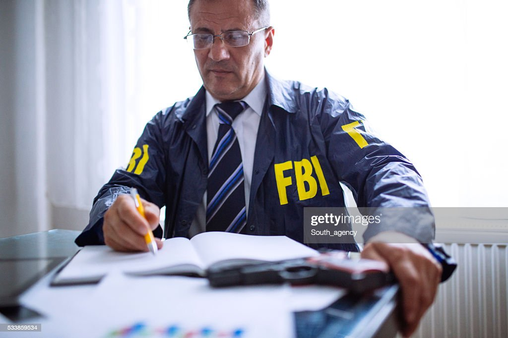 Agent at his office : Stock Photo