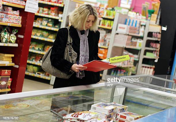 agent conducts a verification of the withdrawal of frozen products containing horse meat in Herouville SaintClair northwestern France on February 26...