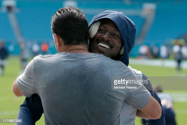 Agent Drew Rosenhaus hugs wide receiver Antonio Brown of the New England Patriots prior to the game against the Miami Dolphins at Hard Rock Stadium...