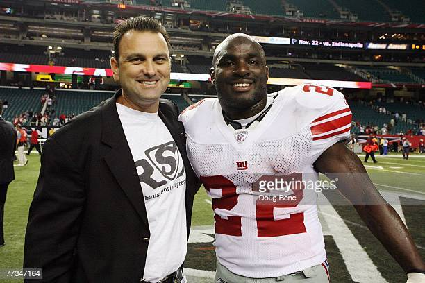 Agent Drew Rosenhaus poses with Reuben Droughns of the New York Giants after the game against the Atlanta Falcons at Georgia Dome on October 15, 2007...