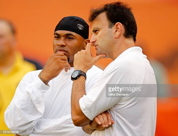 Agent Drew Rosenhaus talks with Steve Smith of the Carolina Panthers before an NFL game against the Miami Dolphins at Sun Life Stadium on August 19,...