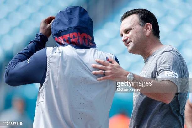 Agent Drew Rosenhaus talks with wide receiver Antonio Brown of the New England Patriots prior to the game against the Miami Dolphins at Hard Rock...