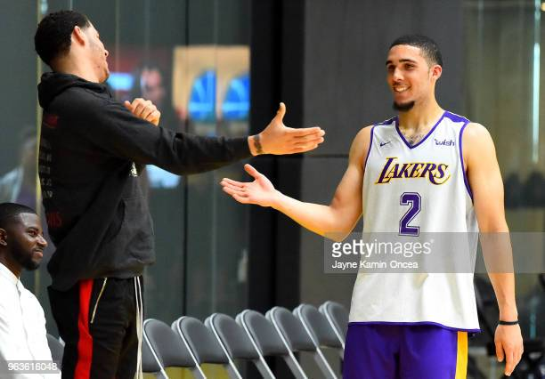 Agent Harrison Gaines looks on as Lonzo Ball of the Los Angeles Lakers greets his brother LiAngelo Ball after he completed his NBA PreDraft Workout...