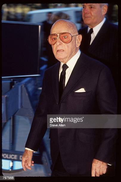 Agent Irving Swifty Lazar attends a memorial service for broadcasting executive William Paley November 12 1990 in New York City Paley founded the...