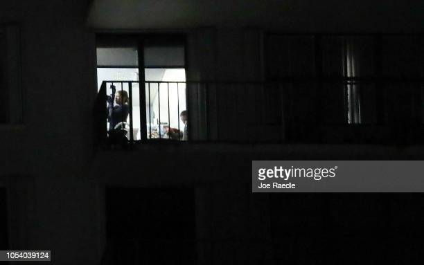Agent is seen using a camera to document the interior of a condo in the building that has a possible connection to alleged bomber Cesar Sayoc and his...
