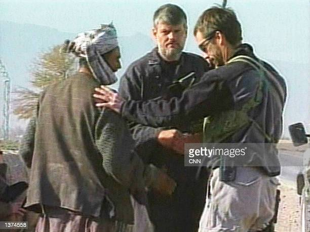 A CIA agent known as Dave and a US Special Forces soldier speak with a Northern Alliance commander November 27 2001 in Mazare Sharif Afghanistan Dave...
