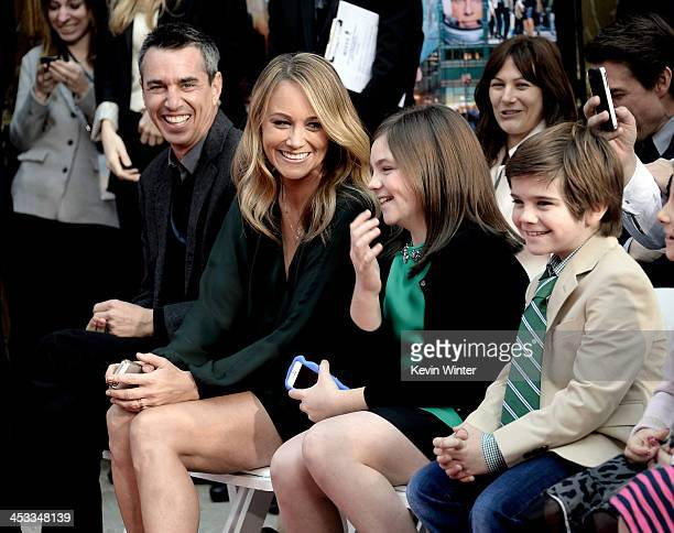Agent Nick Stevens, actress Christine Taylor and her children Ella Stiller and Quinlin Stiller watch as actor Ben Stiller is honored with a hand and...