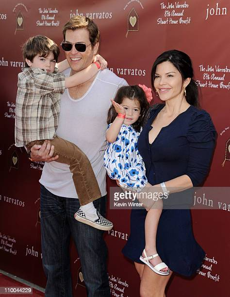 Agent Patrick Whitesell his wife Lauren Sanchez and their children Evan and Ella arrive at John Varvatos' 8th Annual Stuart House Benefit at the John...