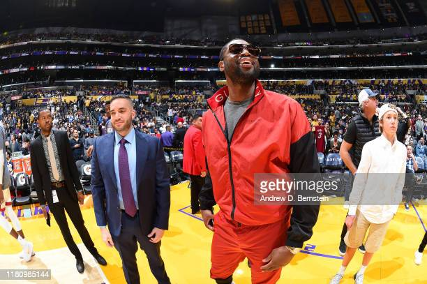 Agent Rich Paul, James Goldestein, and Former NBA Player, Dwyane Wade talk before the game between the Los Angeles Lakers and the Miami Heat on...