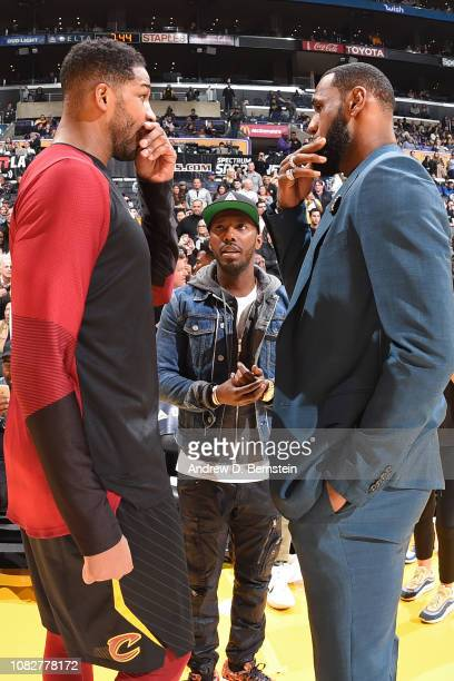 Agent Rich Paul Tristan Thompson of the Cleveland Cavaliers and LeBron James of the Los Angeles Lakers talk before the game on January 13 2019 at...