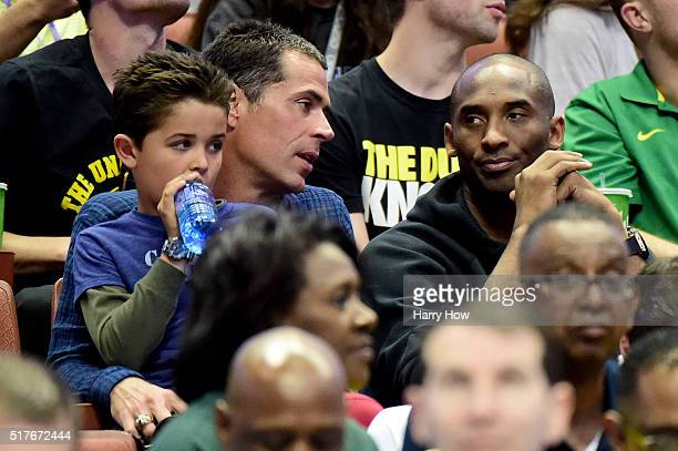 Agent Rob Pelinka talks with Kobe Bryant during the NCAA Men's Basketball Tournament West Regional Final at Honda Center on March 26 2016 in Anaheim...