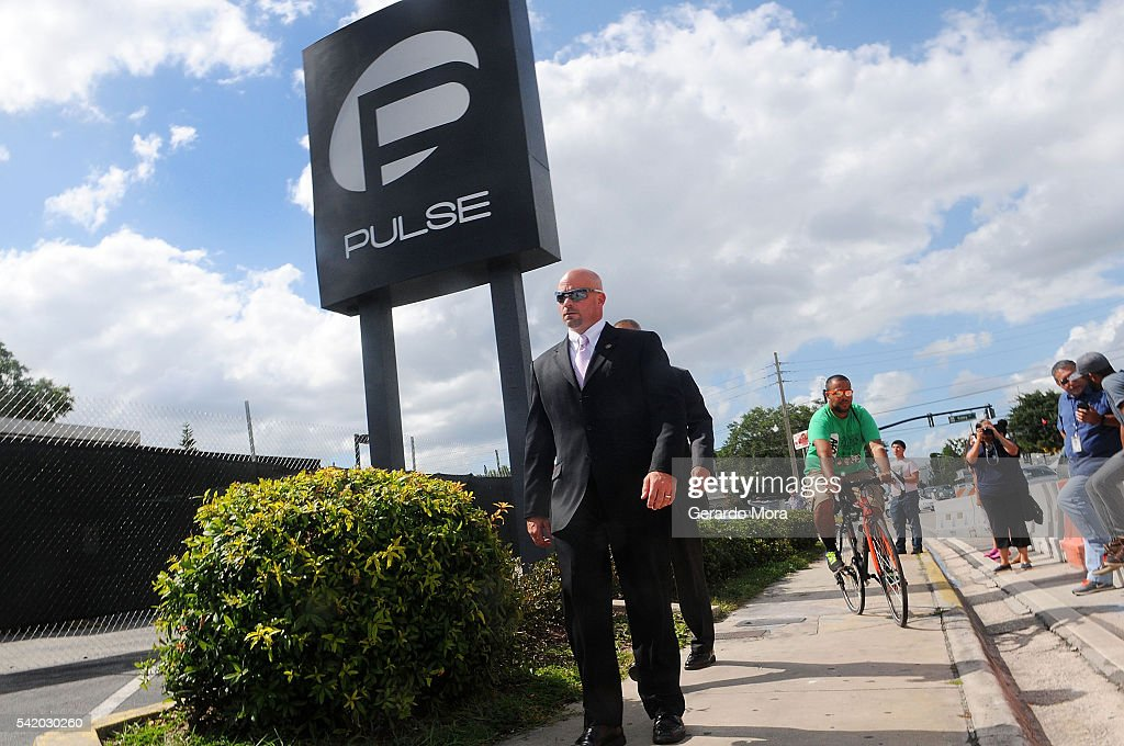 FBI agent Ronald Hopper walks in front of the Pulse nightclub on June 21, 2016 in Orlando, Florida. The Orlando community continues to mourn the victims of the deadly mass shooting at a gay nightclub.