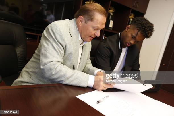 Agent Scott Boras watches as first round draft pick Kyler Murray of the Oakland Athletics signs his contract at the Oakland Alameda Coliseum on June...