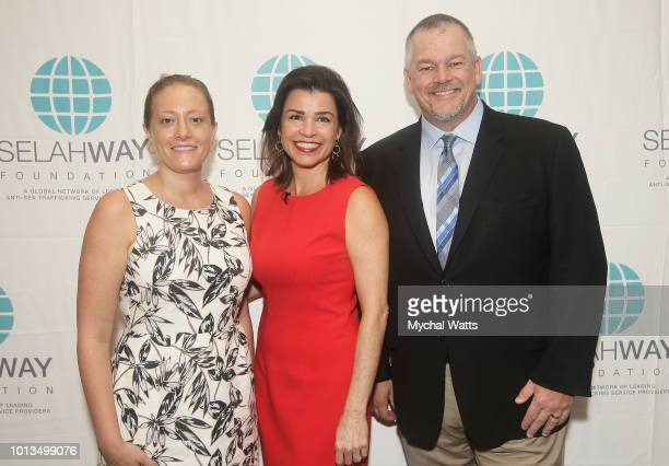 Agent Victim Specialist Laura B Riso Elizabeth Mendez Fisher with Alan Smyth attend the Selway Foundation Luncheon at Wells Fargo 42nd St on August 8...
