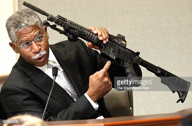 Agent Walter A. Dandridge Jr., holds the bushmaster rifle used in the sniper shootings, during his testimony in the trial of sniper suspect John...