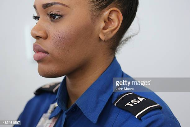 TSA agent watches an xray monitor while screening luggage at a special TSA Precheck lane at Terminal C of the LaGuardia Airport on January 27 2014 in...