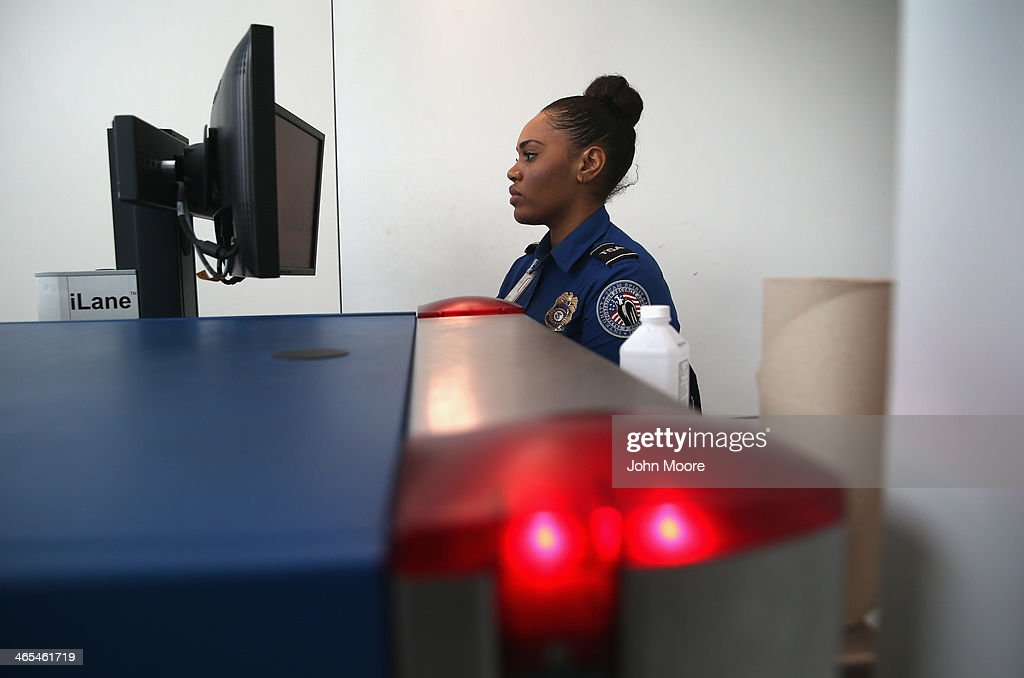A TSA agent watches xray monitors while screening luggage at a special TSA Pre-check lane at Terminal C of the LaGuardia Airport on January 27, 2014 in New York City. Once approved for the program, travelers can use special expidited Pre-check security lanes. They can also leave on their shoes, light outerwear and belt, as well as keep their laptop and small containers of liquids inside carry-on luggage during security screening. The TSA plans to open more than 300 application centers across the country.