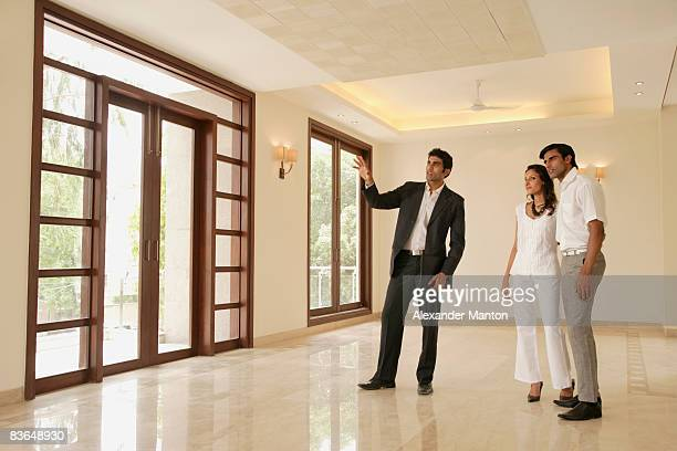 agent with young couple