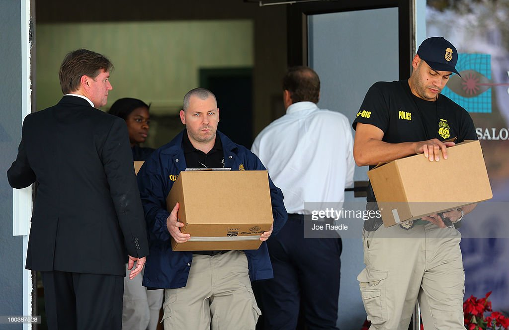 FBI agents and other law enforcement officials are seen as they carry boxes out of the medical-office complex of Dr. Salomon Melgen who has possible ties to U.S. Sen. Bob Menendez (D-NJ) on January 30, 2013 in West Palm Beach, Florida. The agents arrived last night at the medical-office complex and started hauling away potential evidence in several vans.
