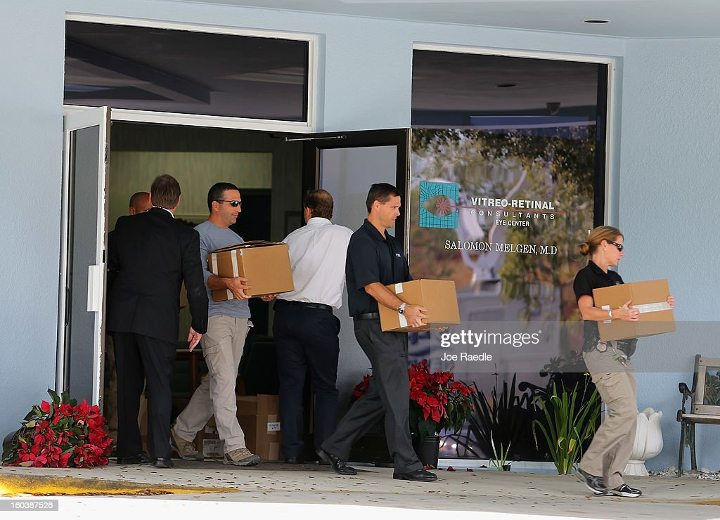 FBI agents and other law enforcement officials carry boxes out of the medical-office complex of Dr. Salomon Melgen who has possible ties to U.S. Sen. Bob Menendez (D-NJ) on January 30, 2013 in West Palm Beach, Florida. The agents arrived last night at the medical-office complex and started hauling away potential evidence in several vans.