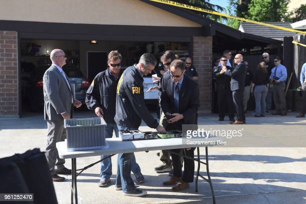 FBI agents and other law enforcement officials search the home of 72yearold Joseph James DeAngelo in Citrus Heights Calif in a bid to solve a...