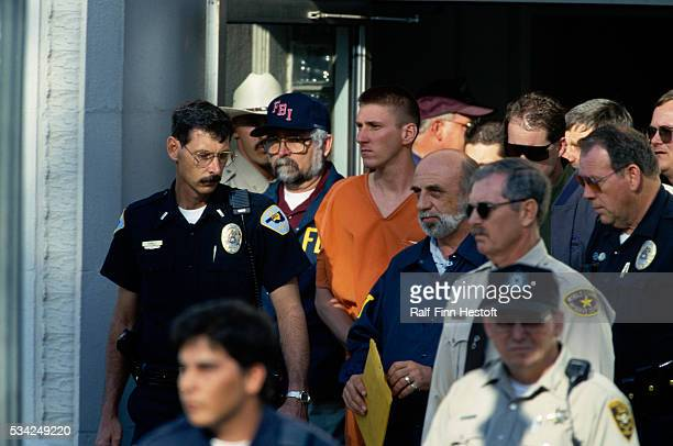 FBI agents and police officers escort Oklahoma City bombing suspect Timothy McVeigh from the Noble County Courthouse On April 19th a...