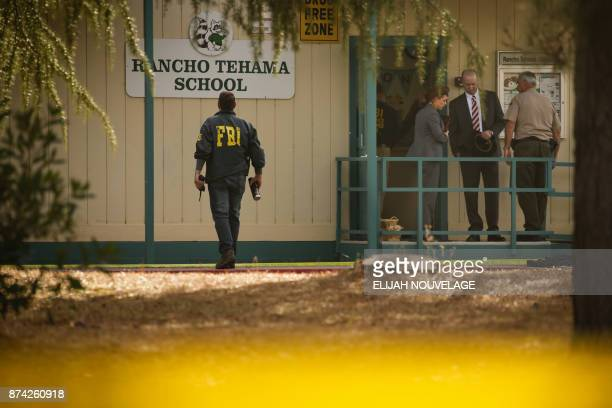 TOPSHOT FBI agents are seen behind yellow crime scene tape outside Rancho Tehama Elementary School after a shooting in the morning on November 14 in...