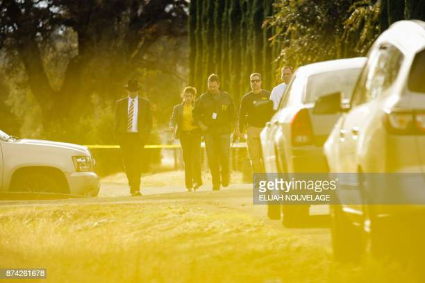 FBI agents are seen behind yellow crime scene tape outside Rancho Tehama Elementary School after a shooting in the morning on November 14 in Rancho...