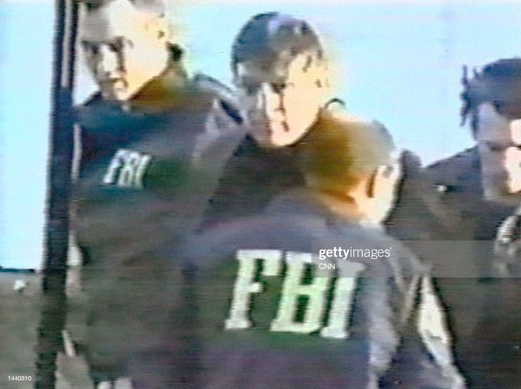 FBI agents arrest counterintelligence agent Robert Hanssen (C) near his home February 18, 2001 in Vienna, Virginia. According to the FBI, Hanssen had just placed a package of classified material in a park he had been using since 1985 to exchange documents with Russian spies. Hanssen is currently serving a prison sentence of life without parole.