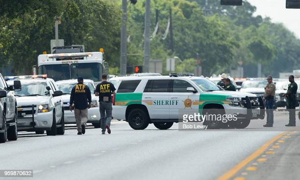 ATF agents arrive on location at Santa Fe High School where a shooter killed at least 10 students on May 18 2018 in Santa Fe Texas At least 10 people...
