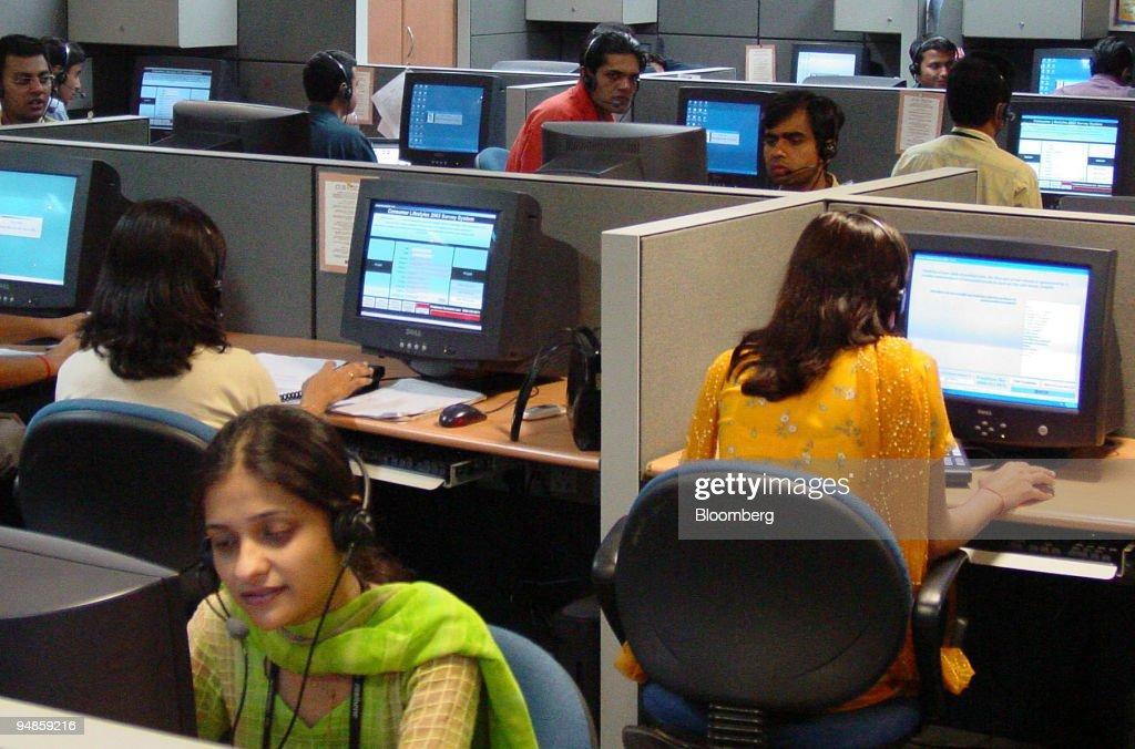 Agents attend to customer calls at New Delhi-based NIIT Ltd. : News Photo
