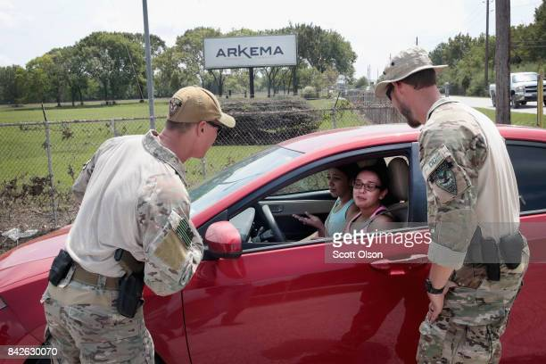 FBI agents check a vehichle at the gate of the Arkema plant which received major damage from flooding caused by Hurricane and Tropical Storm Harvey...