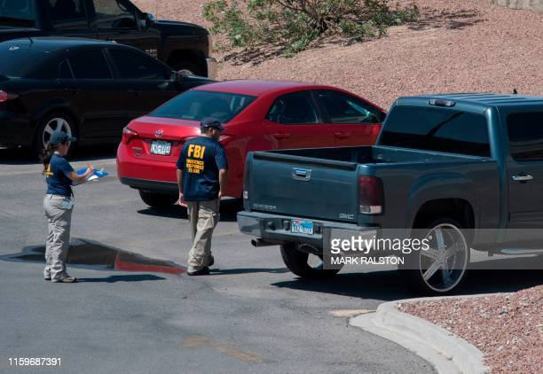 FBI agents check a vehicle outside the Cielo Vista Mall WalMart where a shooting left 20 people dead in El Paso Texas on August 4 2019 Texas...