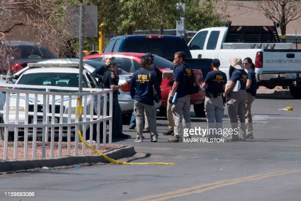 FBI agents check vehicles outside the Cielo Vista Mall WalMart where a shooting left 20 people dead in El Paso Texas on August 4 2019 Texas...