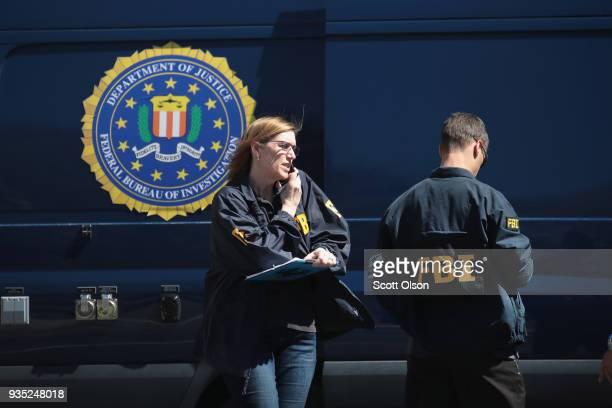 FBI agents collect evidence at a FedEx Office facility following an explosion at a nearby sorting center on March 20 2018 in Sunset Valley Texas A...
