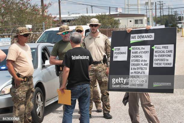 FBI agents confront protestors at the gate of the Arkema plant which received major damage from flooding caused by Hurricane and Tropical Storm...