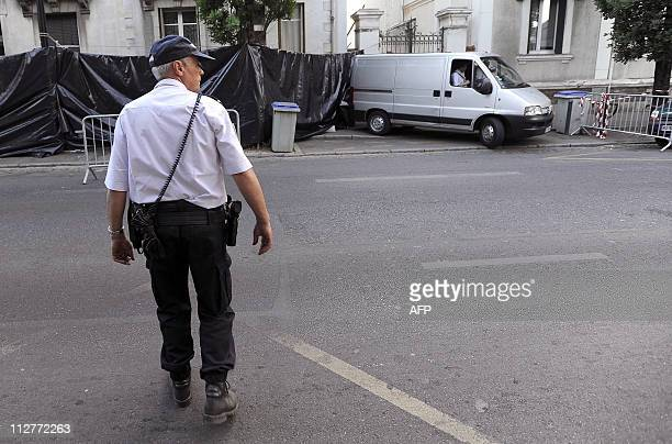 Agents evacuate a fifth body from the house of a family who disappeared 17 days ago on April 21 2011 in Nantes French police launched a murder probe...