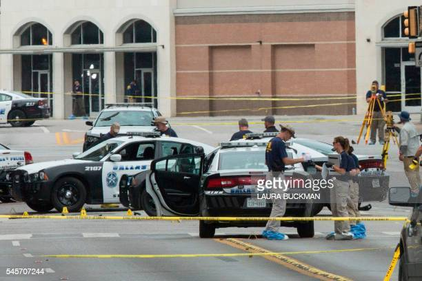 TOPSHOT FBI agents examine the crime scene of the Dallas Texas sniper shooting on July 9 2016 The e gunman behind a sniperstyle attack in Dallas was...