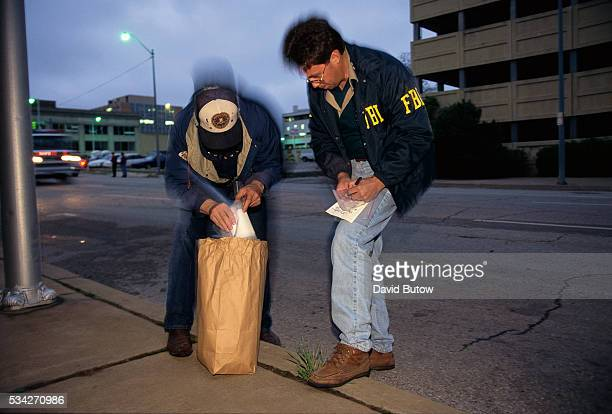 Agents from the ATF and FBI search for evidence near the Oklahoma City bomb site on the day of the attack On April 19 Timothy McVeigh exploded a...