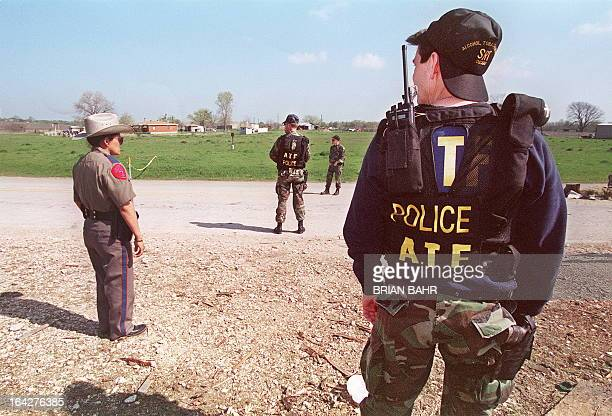 Agents from the Bureau of Alcohol Tobacco and Firearms and local Texan authorities shown in a file photo dated 26 March 1993 standing at a checkpoint...