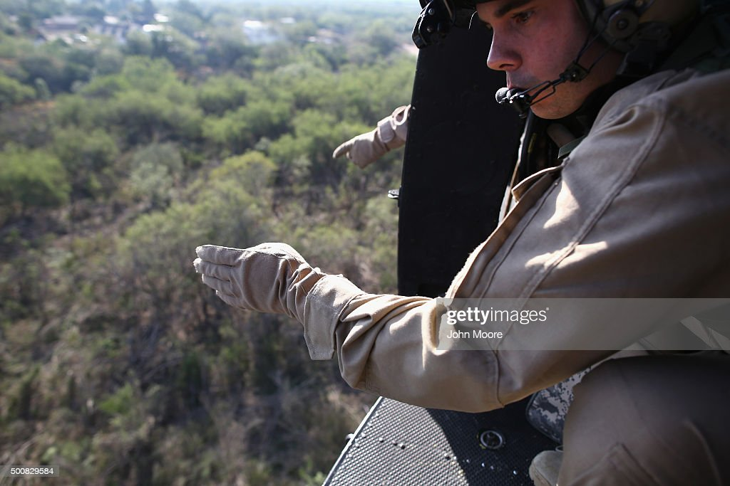 Agents from U.S. Air and Marine Operations (AMO), find undocumented immigrants while flying in their helicopter near the U.S.-Mexico border on December 10, 2015 at La Grulla, Texas. The number of families and unaccompanied minors illegally crossing the border from Central America into Texas' Rio Grande Valley has surged in recent months. Border security remains a key issue in the U.S. Presidential campaign.