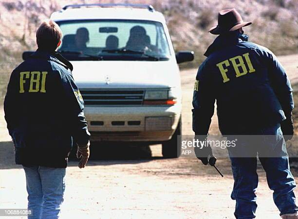 FBI agents guard 05 April the entrance to the property of Theodore Kaczynski the 53yearold Harvard graduate who authorites suspect is the Unabomber...