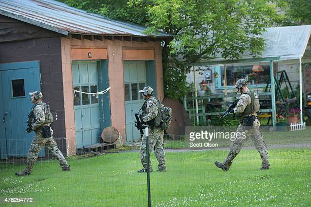 FBI agents help in the search for convicted murderers Richard Matt and David Sweat on June 24 2015 in Whippleville New York Matt and Sweat were...